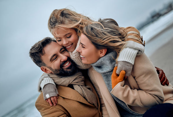 Family wrapped up in winter coats and woollens