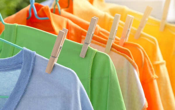 colourful array of shirts hanging out to dry