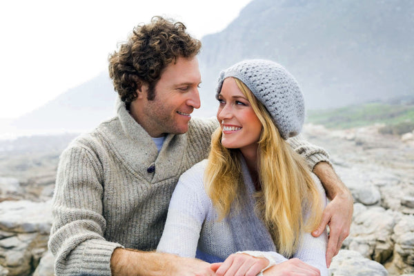 couple wearing soft cashmere sweaters