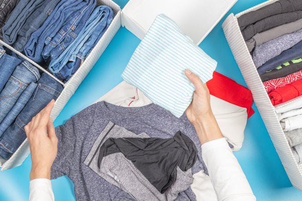 Folded t-shirts and denim pants in drawers