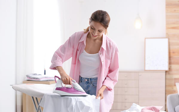 ironing out remaining creases from your garments after storage