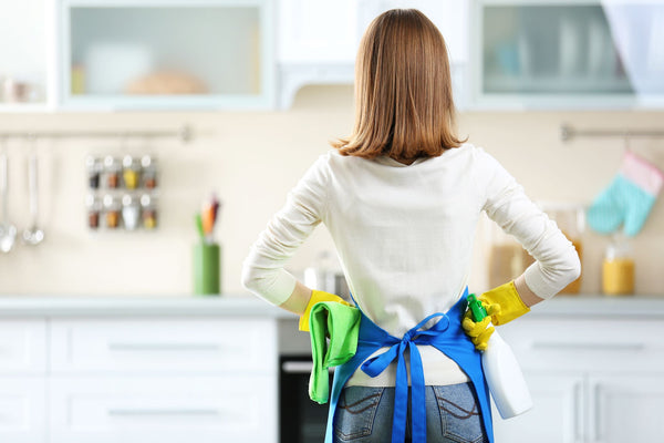 woman surveying her kitchen after cleaning it