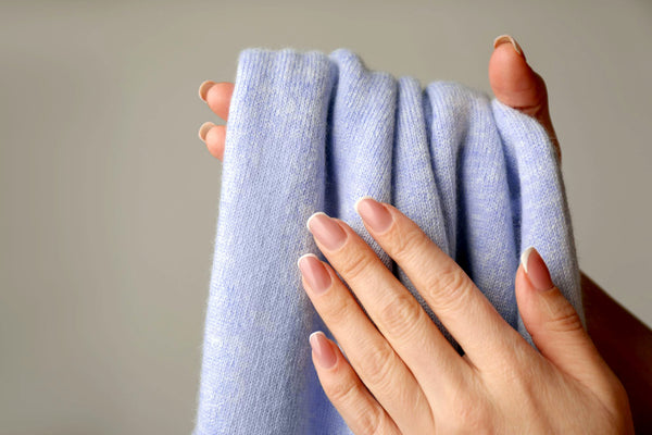 hands holding cashmere material