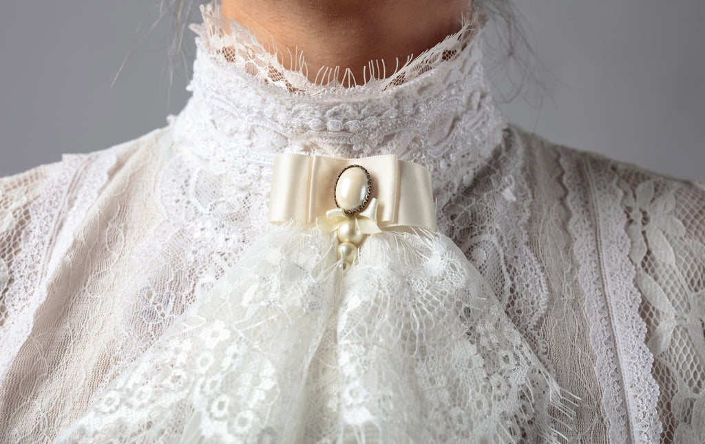 intricate victorian lace on the neck of a dress