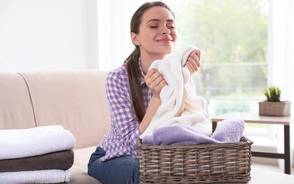 woman smelling clean fresh laundry