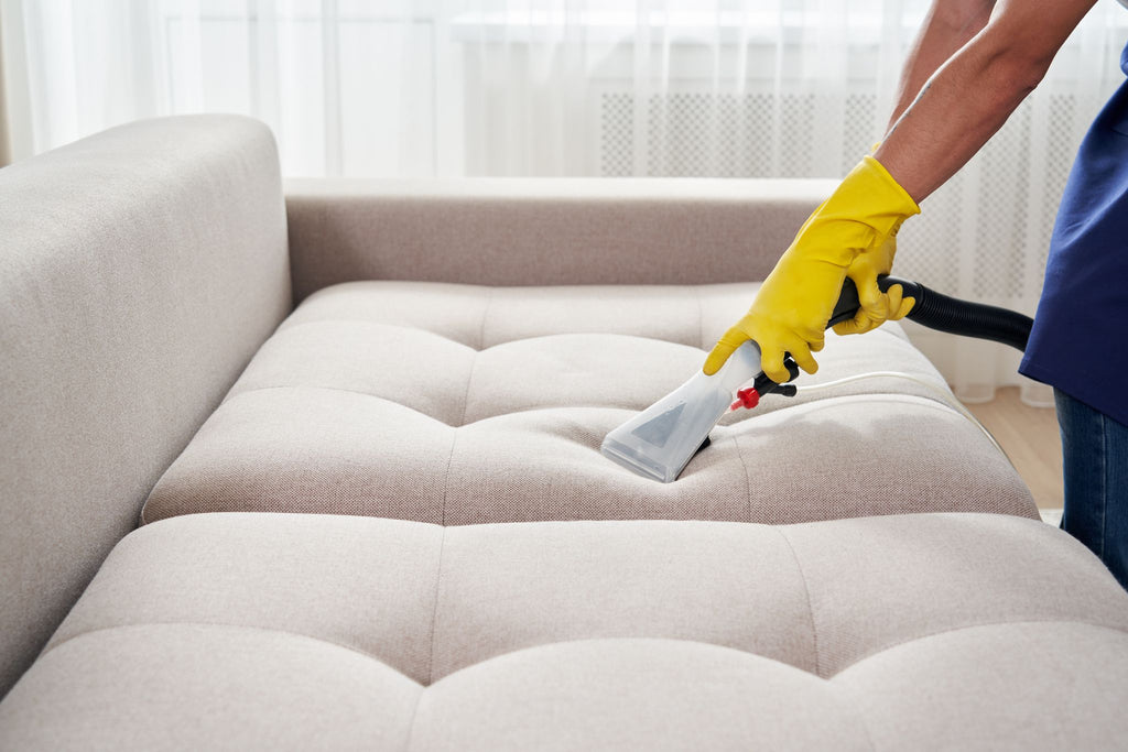 a wet-vac being used to clean a couch