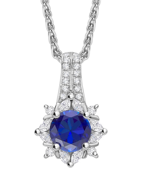 Round cut solitaire sapphire and diamond pendants & necklaces set in halo setting. Kitney London