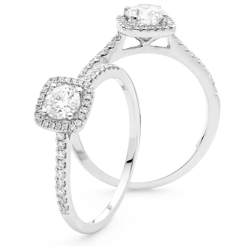 White gold round cut diamond engagement ring in square halo setting. Kitney London Engagement rings