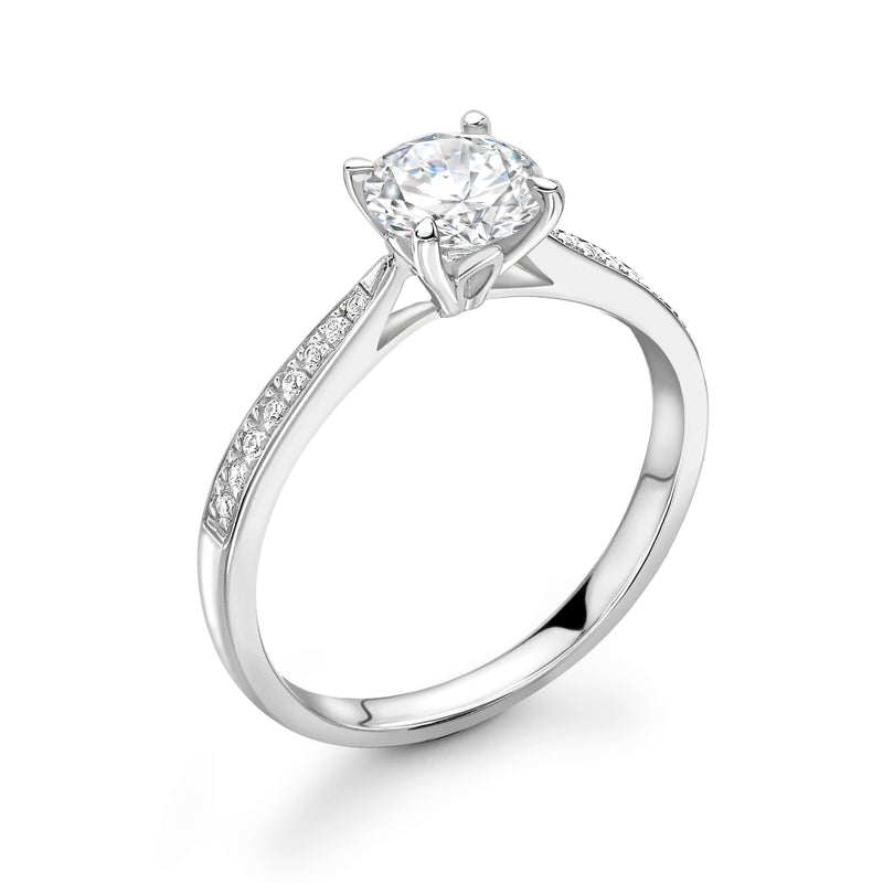 Diamond solitaire engagement ring. Round brilliant cut diamond engagement ring set in 18k white gold