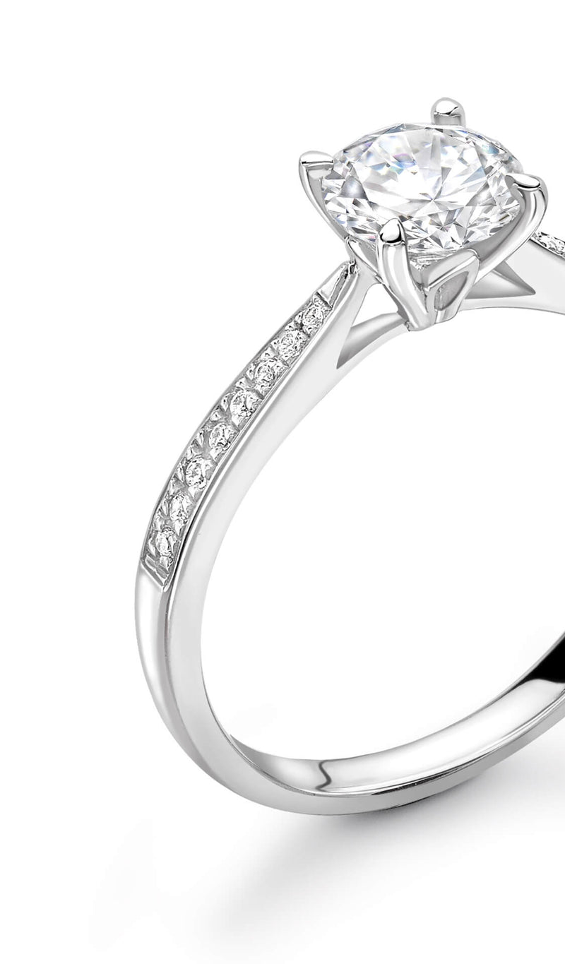 Diamond solitaire engagement ring. Round brilliant cut diamond set in 18k white gold. Kitney London