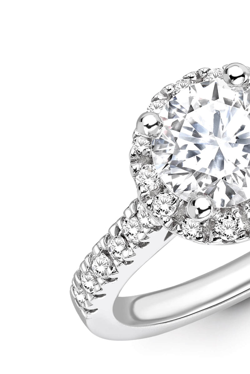 Round Brilliant Cut diamond ring set in 18k white gold. Diamond engagement rings. Kitney London Jewellery