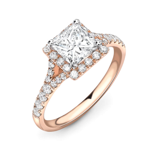 Rose gold diamond engagement ring. Princess cut diamond in halo setting. Kitney London diamonds