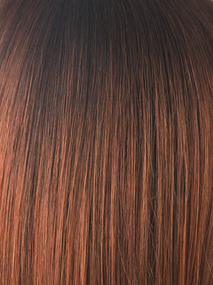 Noriko Wigs | CRIMSON-LR | Deep Burgundy Root that gradually blends into a Lighter Coppery Tone, with the Lightest Points falling around the face, creating a multi-dimensional Jeweled Color