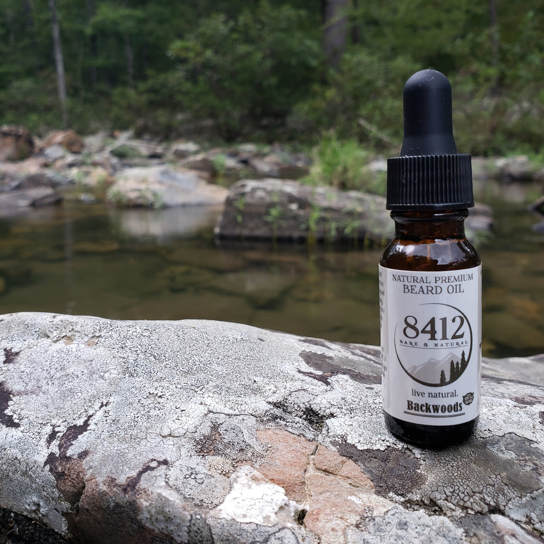 Backwoods Premium Beard Oil - For the true outdoorsman. Whether you're a hiker, camper or you just like to hunt grizzly bears, this blend is perfect for the man in the backwoods. We've blended pure essential oils from trees native to India, South America and Northern Australia. Truly a back country feel.