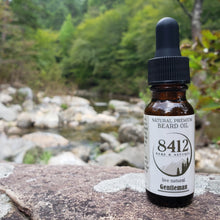 Load image into Gallery viewer, Gentleman Premium Beard Oil is for the true Gentleman. We use oils from the woods of different trees like Blue Spruce and Black Spruce, Hinoki Cypress, a few different flower oils, then top it off with a little patchouli and clary sage. Welcome, ladies and gentleman... the Gentleman.