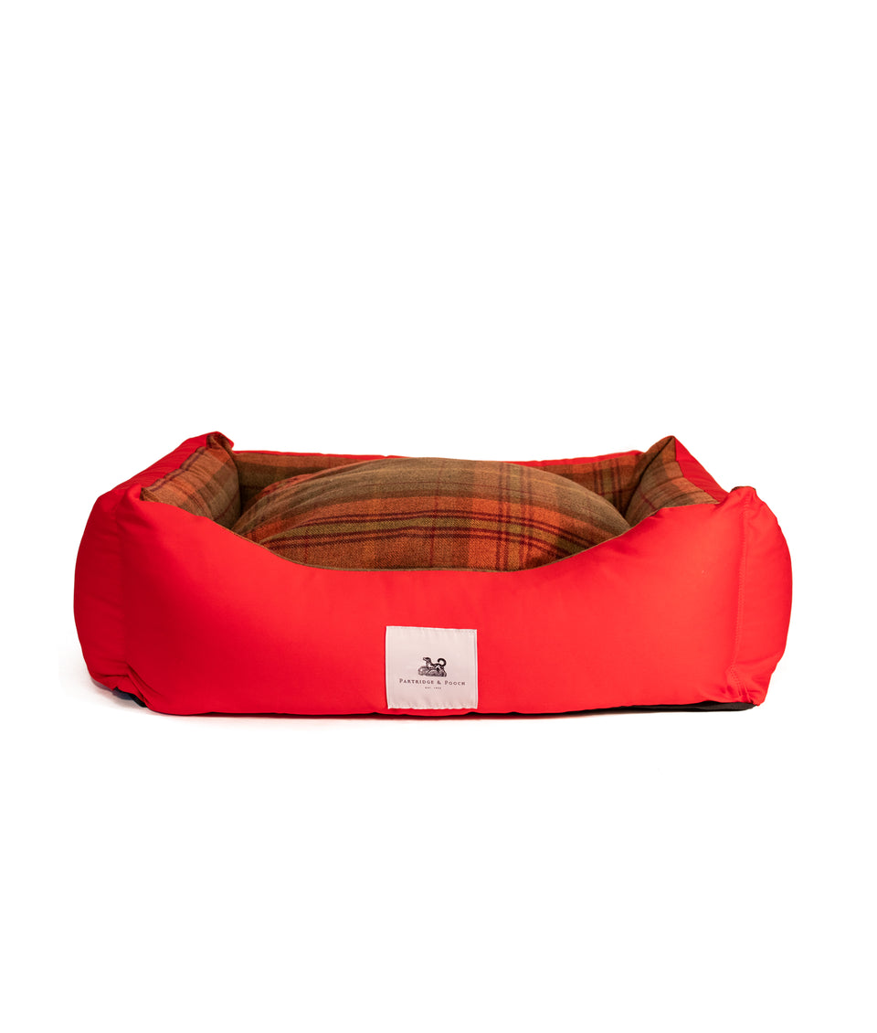 Red dog bed with orange check