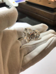loose diamond in hand
