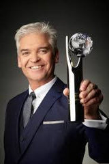 Philip Scofield holding a British Soap Award