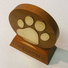 Rounded wood award with brass paw motif