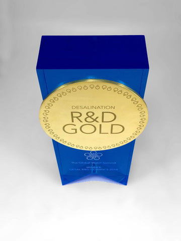 Top down view of blue acrylic and gold medal award