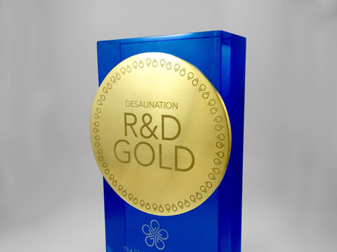Engraved gold medal on blue acrylic body