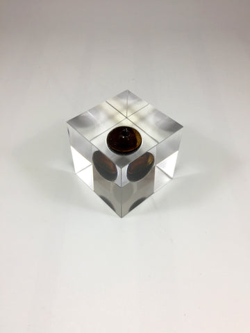 clear acrylic perspex award with crude oil inside