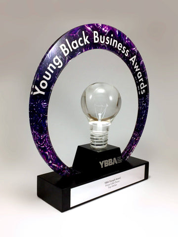 Purple Acrylic Ring with Light Bulb Award Bespoke Mixed Media Awards Creative Awards