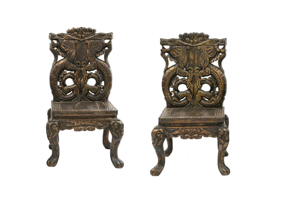 Pair of 20th Century Chinese Carved Side Chairs with Dragon Design