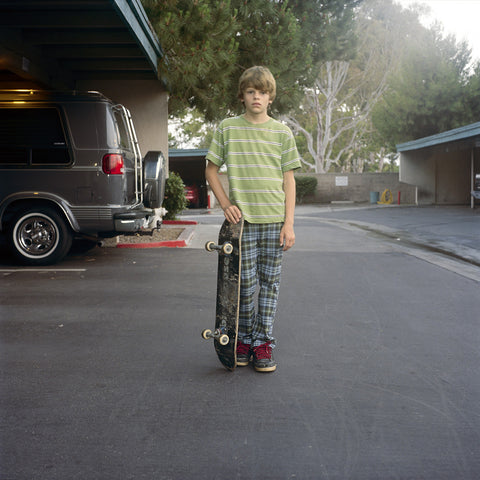 """Boy with Skateboard"" by Michael Stuetz"