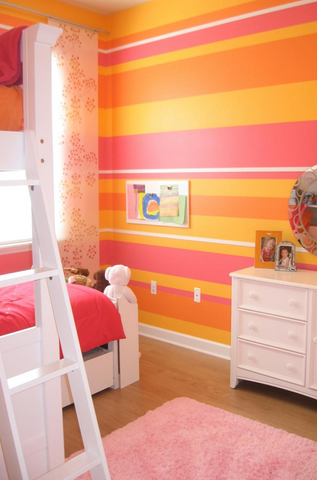 Cheerful spring kid's bedroom with striped walls