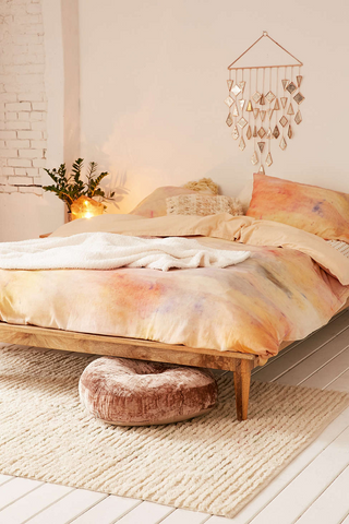 Gold, pink, and soft orange bedding color combo