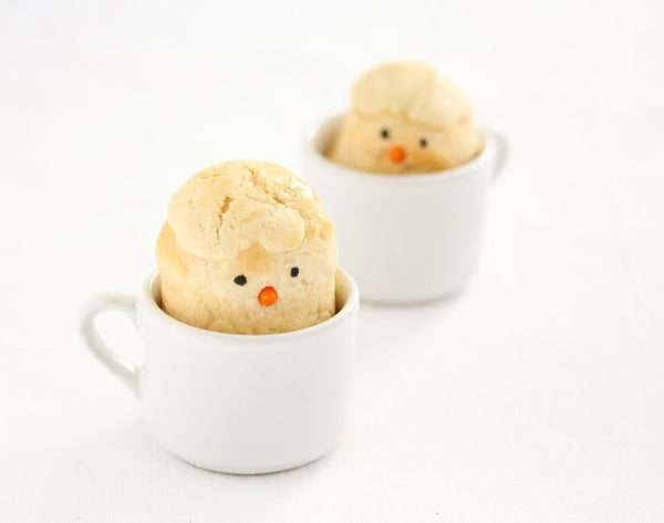 Chick Shaped Bread Rolls peering out of a coffee cup.