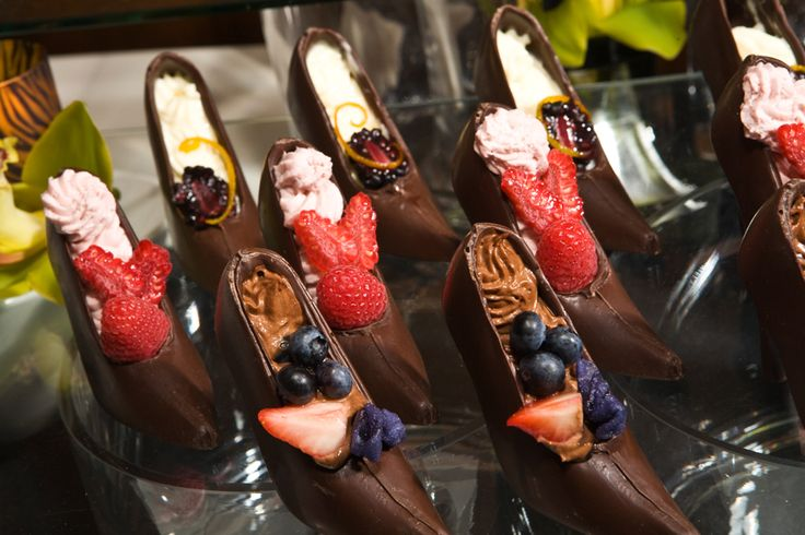 Chocolate High Heels filled with mousse and fresh berries.