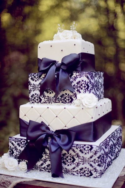 Purple and White Wedding Cake with Ribbons