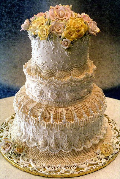Detailed Victorian Wedding Cake with Roses on Top