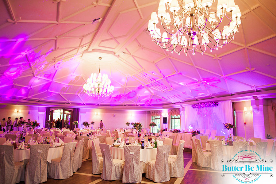 Chandelier and colored lighting at wedding reception