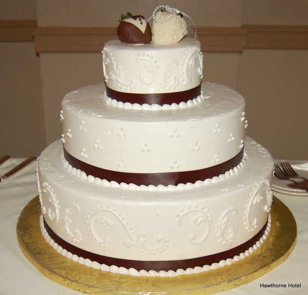 White Wedding Cake with Bride and Groom Strawberries Dipped in Chocolate