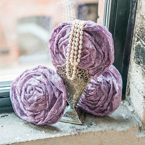 A cluster of Lilac Purple Vintage Fabric Lace Flowers.