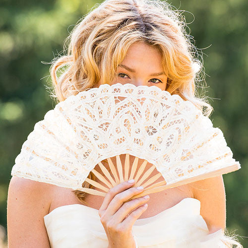 Bride holding a Antiqued Lace Hand Fan