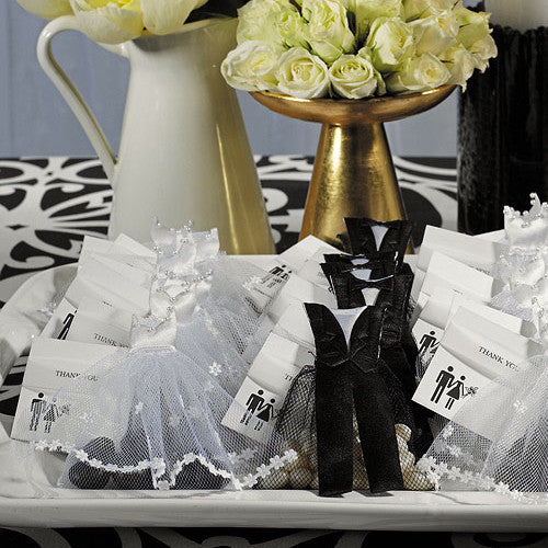 A beautiful display of the Groom & Bride Wedding Favor Candy Bags with yellow flowers.The bags are filled with candy and jelly beans.