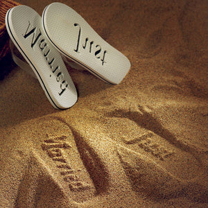 The sand imprint from the bride's Just Married Flip Flop.