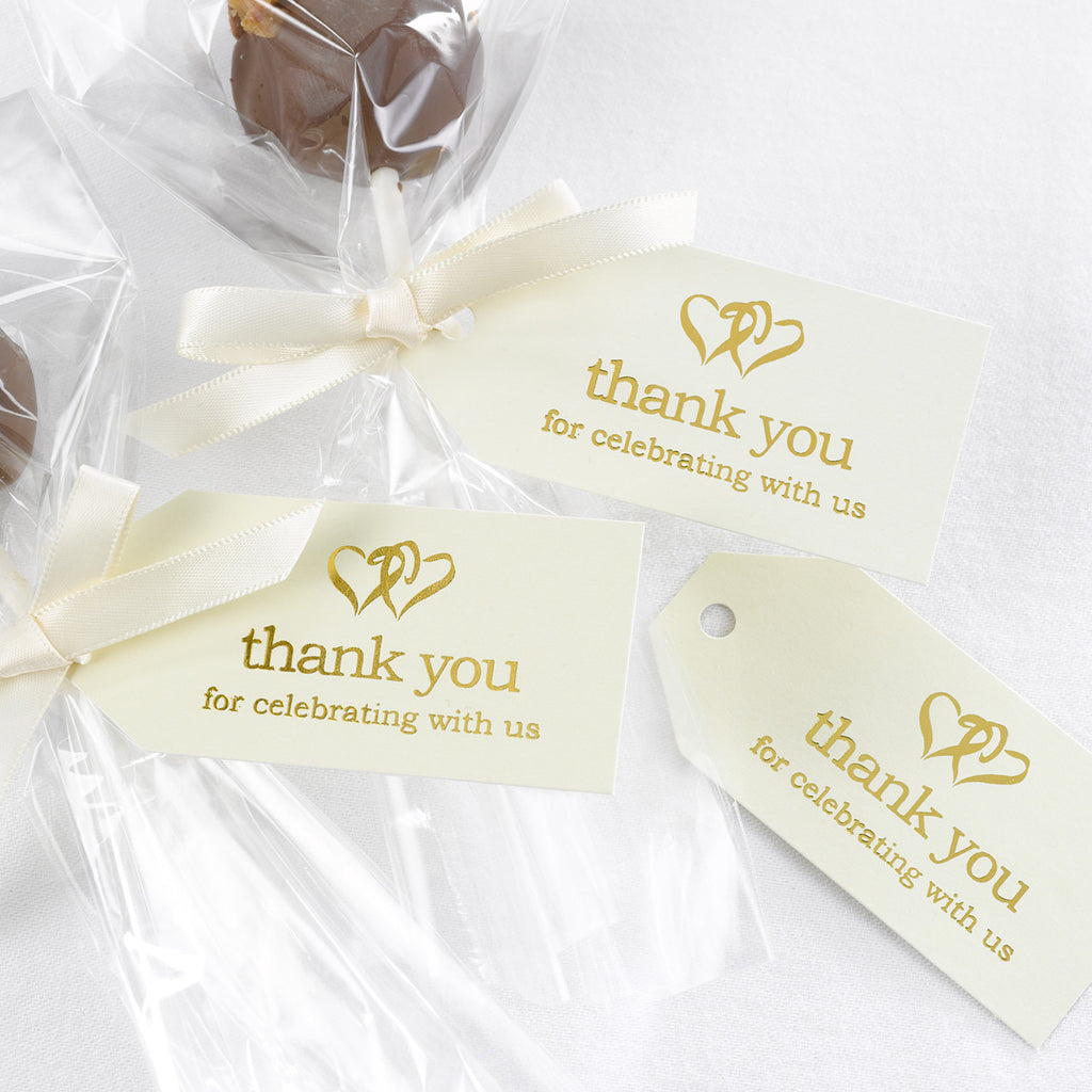 Ivory and Gold Favor Cards attached to wedding favors.