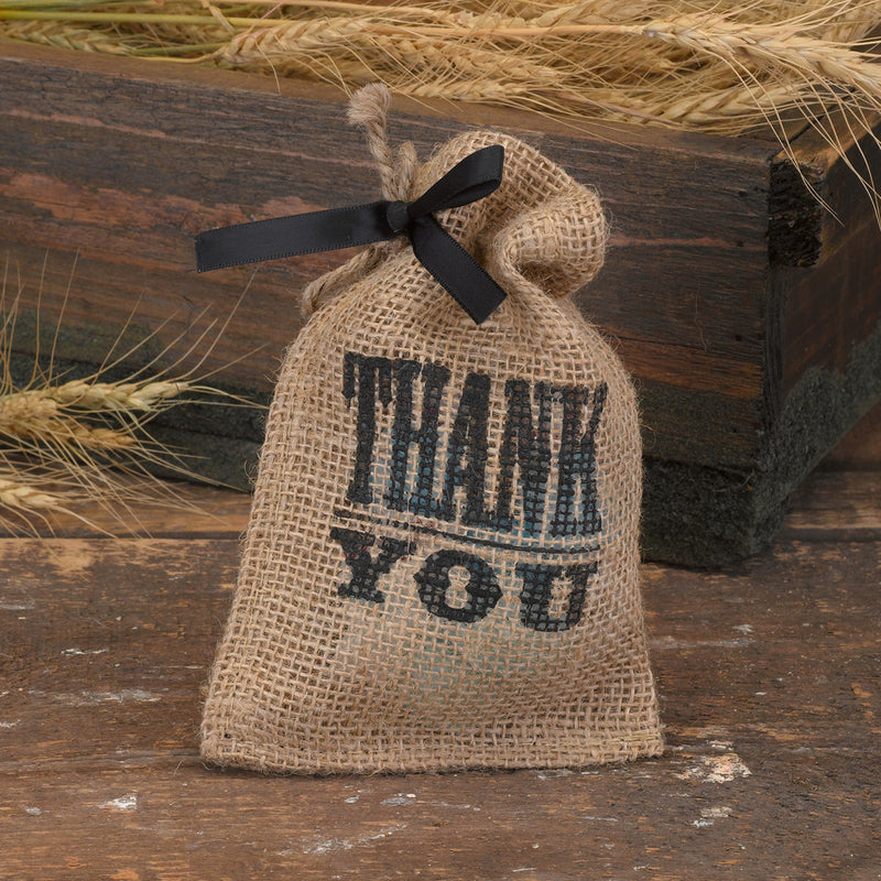 "Give thanks with this burlap party favor bag with twine drawstring closure and black typography with ""Thank You"" design."