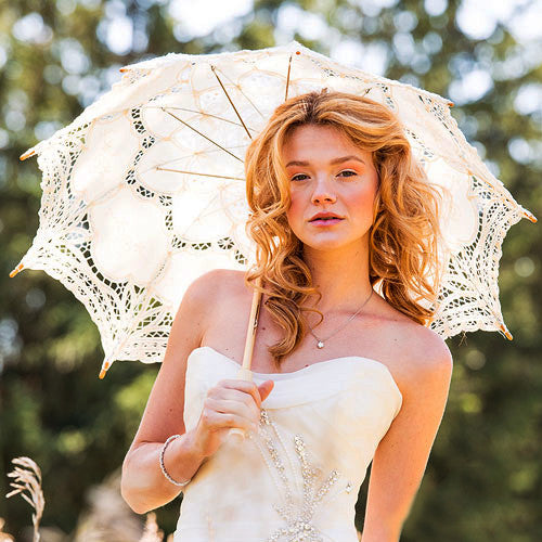 A bride holding the Antiqued Lace Parasol - Size Large.