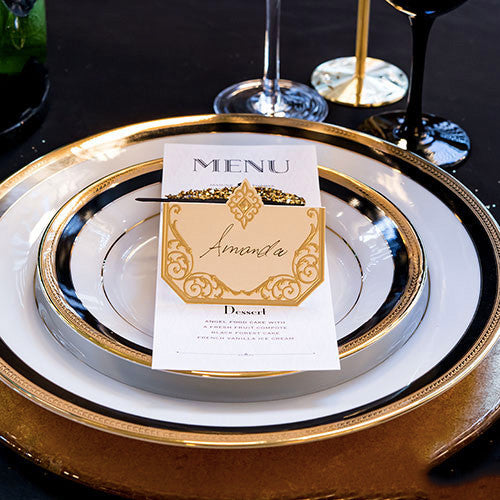 Art Deco Laser Embossed Place Card in gold and ivory a top of a wedding menu.