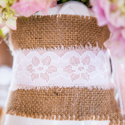 Burlap by the Roll wrapped around a bouquet of flowers