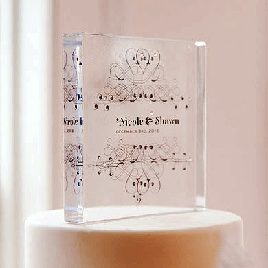 Clear Acrylic Block Cake Topper with the bride and groom's name and the wedding date.
