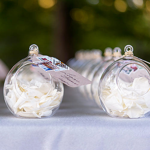 Blown Glass Globe filled with White flowers petals.