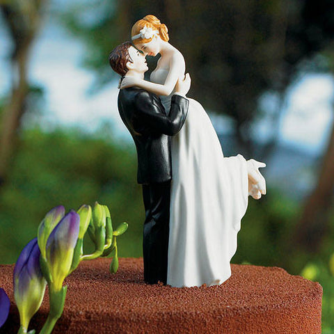 Groom Lifts Bride For Kiss Wedding Cake Topper