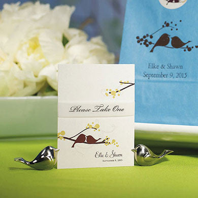 Two Love Bird Card Holders holding a place card.